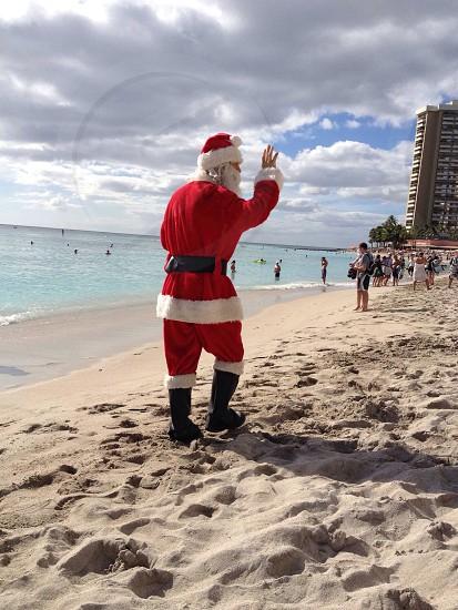 person wearing Santa Claus costume photo