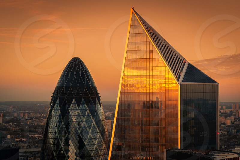 View at  London's landmark buildings during sunset from Sky Garden Terraces. Tips of The Gherkin and The Diamond Bank. photo
