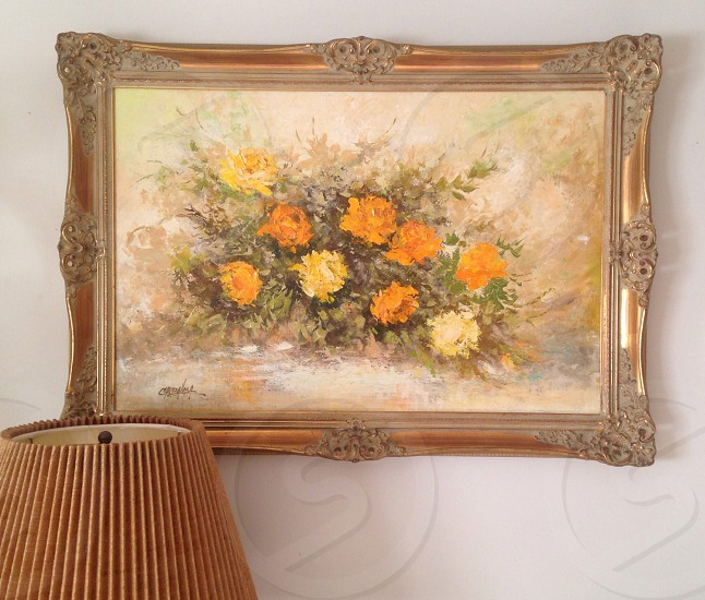 lampshade near flower printed hanging frame photo