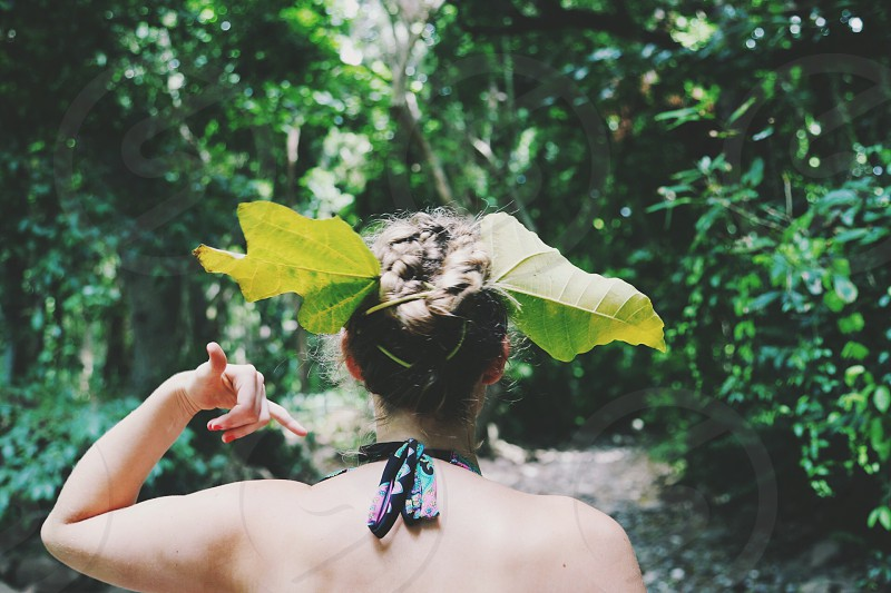 woman with leaf on her head photo