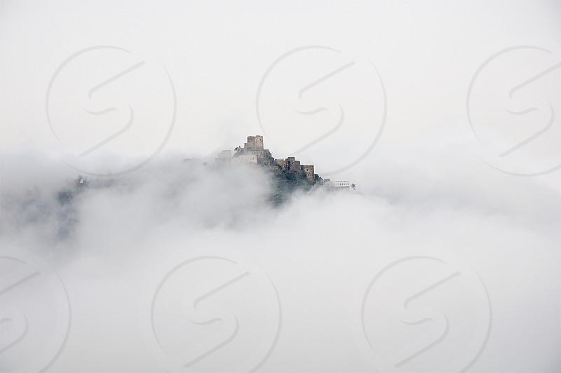 I called it white flames foggy weather buildings on top of mountains and fog to delete all details of image. photo