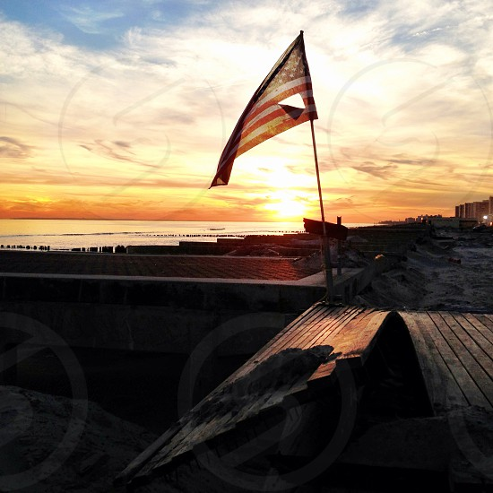 ripped american flag on dock photo