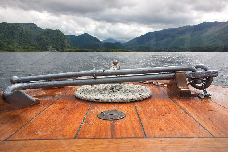 Looking over the bow of a boat in the Lake District. photo