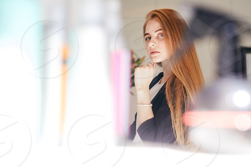 Girl taking care of her hair on hairdresser shop photo
