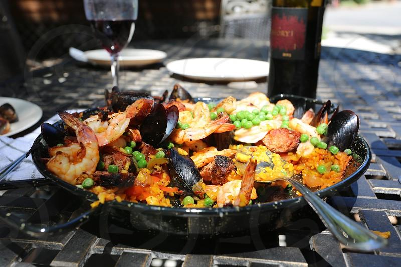 Paella and wine photo