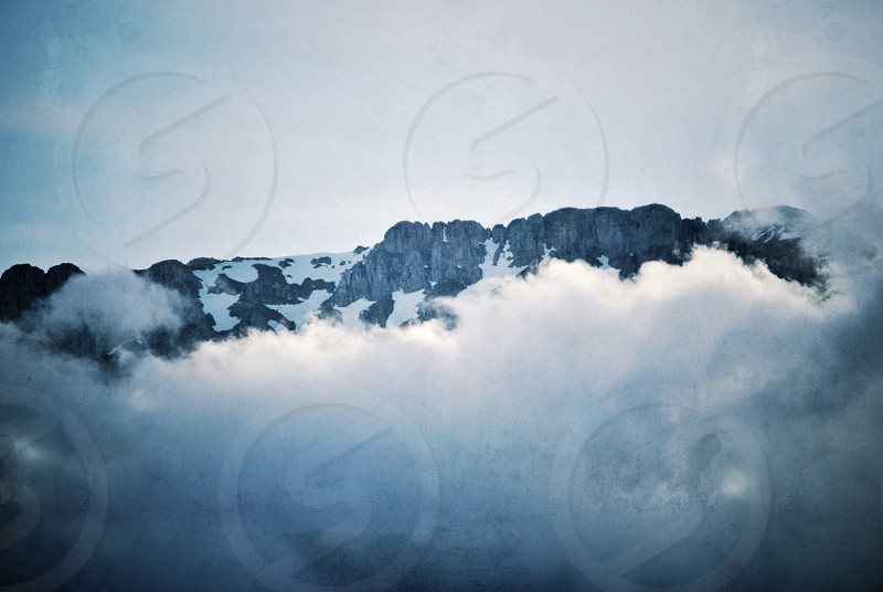 white clouds covered mountain ridge photo