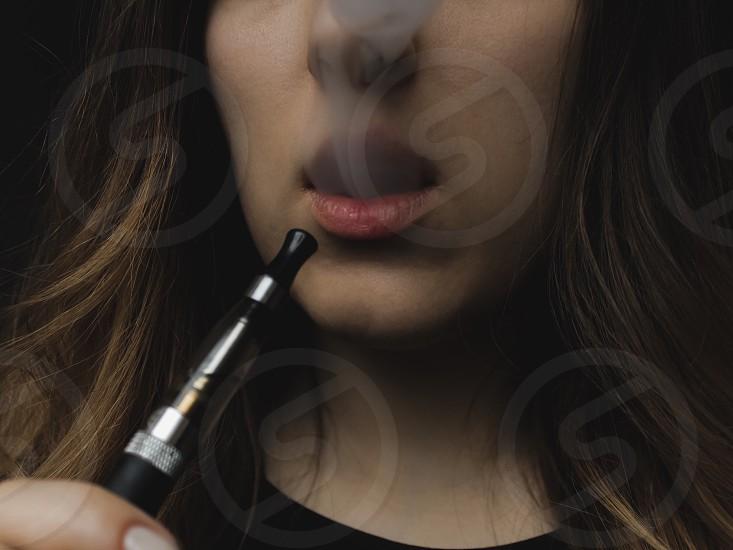 Vaping smoking e-cigarette nicotine vapor cigarettes vaping tricks vape electronic cigarette photo
