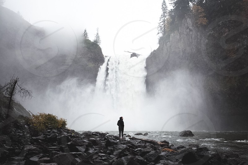 person facing waterfalls photo