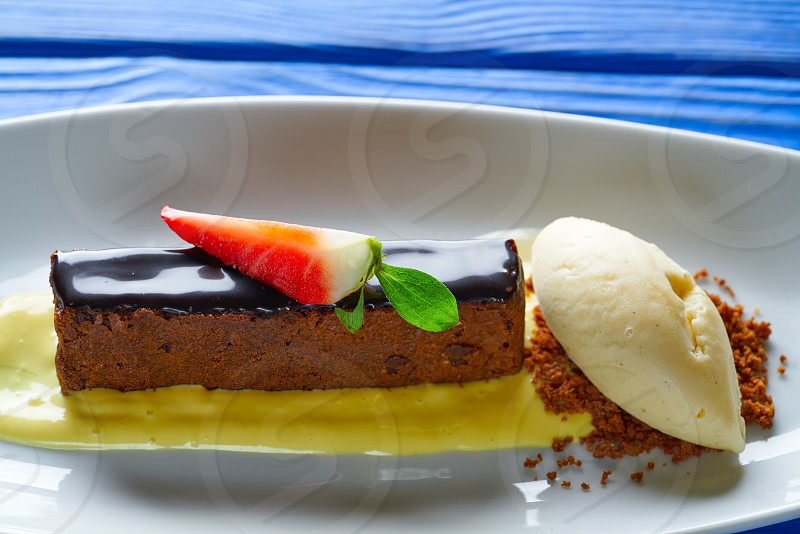 Chocolate brownie with vanilla ice-cream ice cream dessert photo