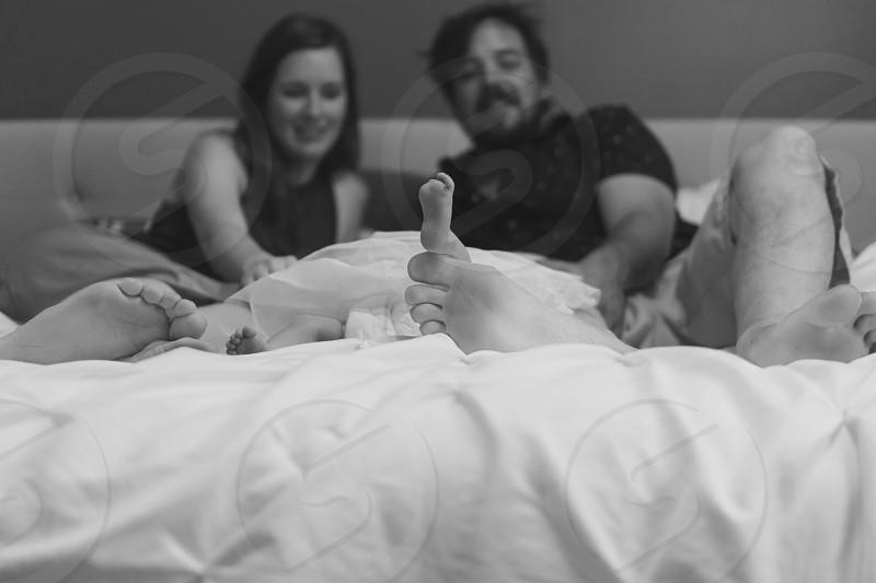 Family who cherishes sleep especially with a newborn  photo