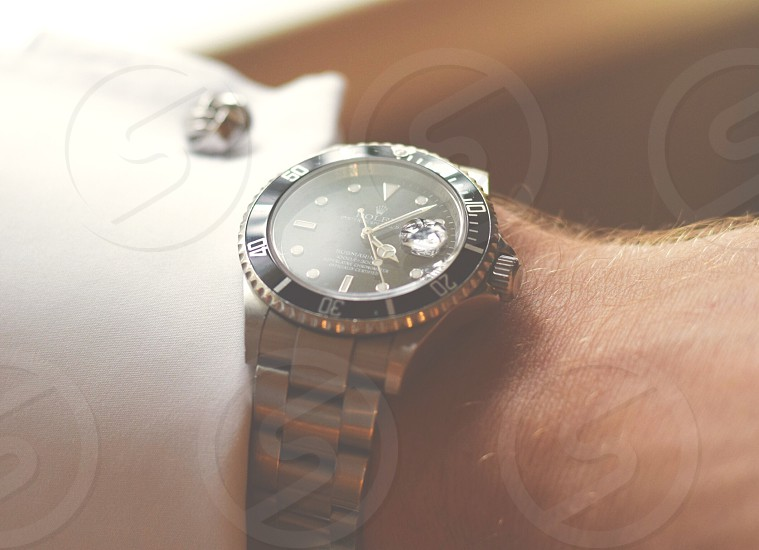 round black analog watch with silver strap photo