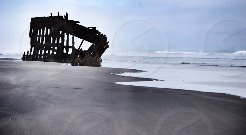 The Wreck of the Peter Iredale has rested on the Oregon Coast for over 100 years. photo