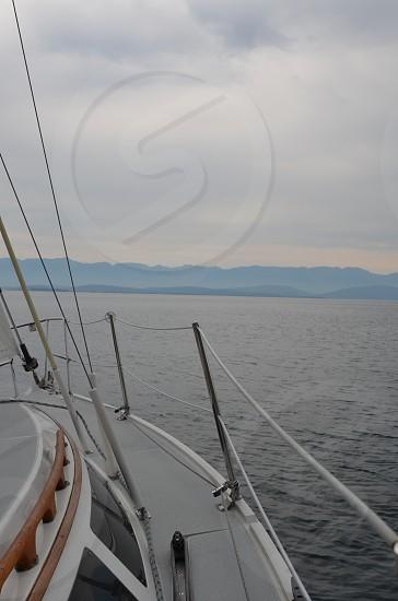 Sailboat sailing water lake nautical hills mountains horizon summer photo