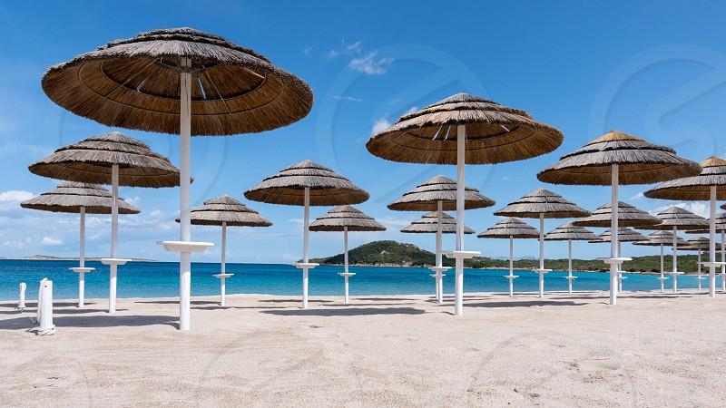 Parasols at Liscia Ruja Beach in Sardinia photo