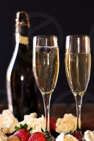 2 clear flute glass with yellow sparkling wine photo