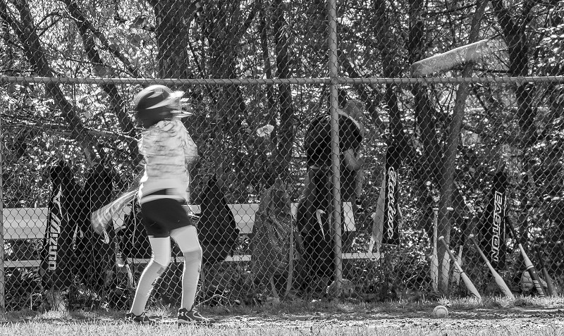 black white photo child hitting baseball photo