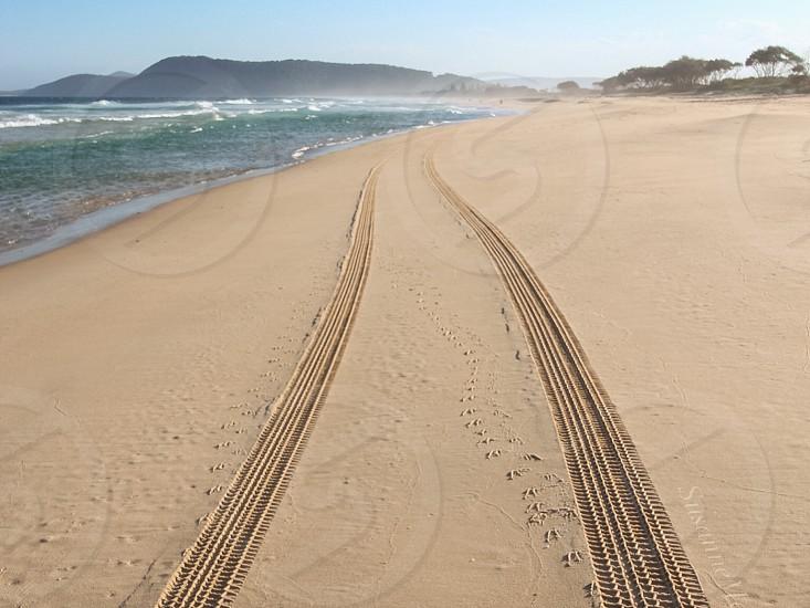 Beach tracks road trip sand sky waves photo