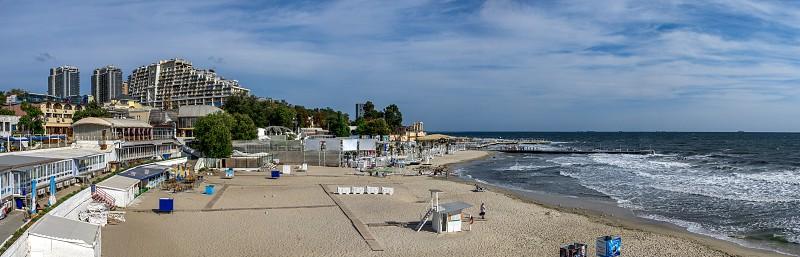 Odessa Ukraine - 09.05.2019. Panoramic view of the autumn beach in the resort of Arcadia in Odessa Ukraine on a sunny day photo
