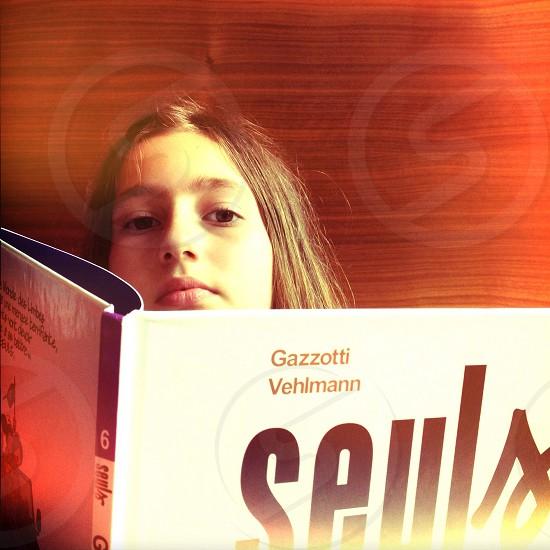 girl holding gazzotti vehlmann book photo