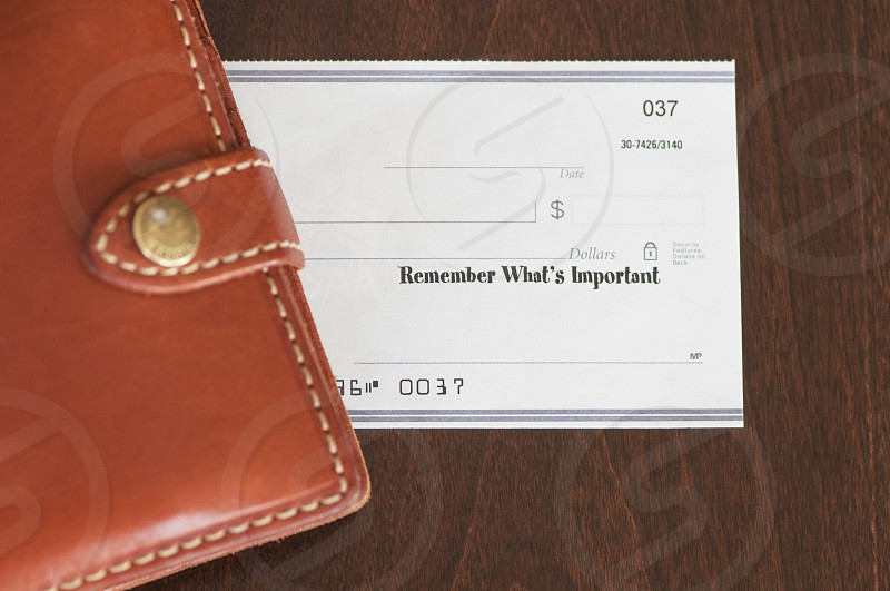 white form card under brown leather wallet photo