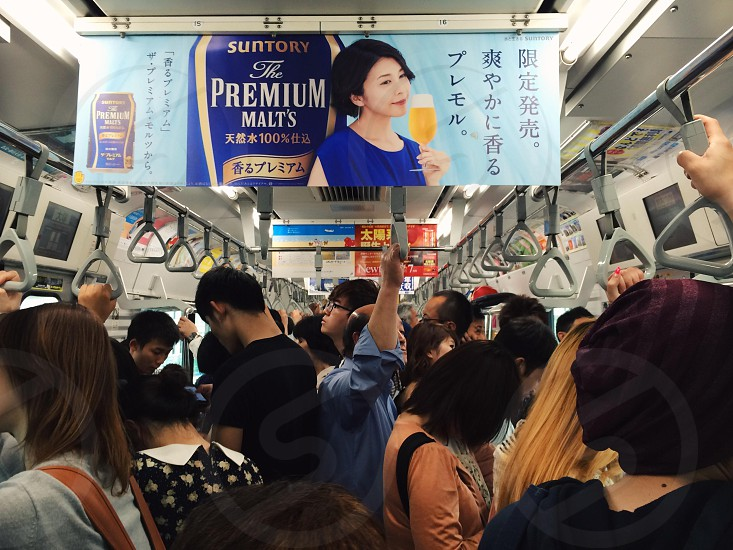 Crowded train in Tokyo.  photo