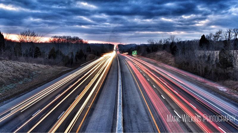 Traffic cars interstate taillights headlights evening dusk  photo