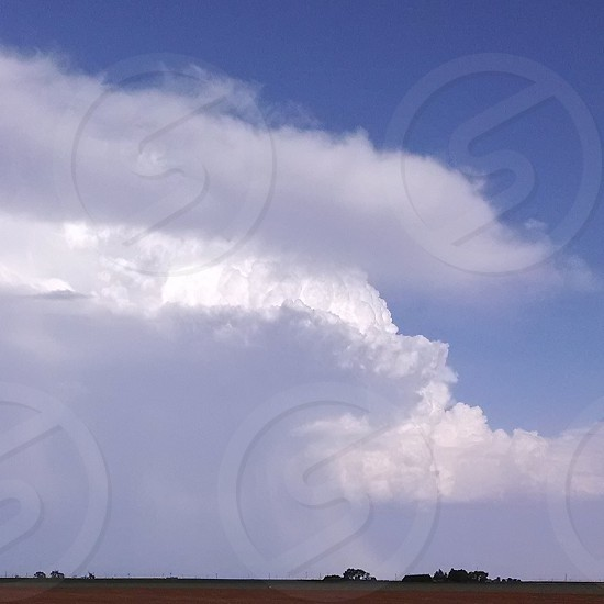 Stormy afternoon clouds rural photo