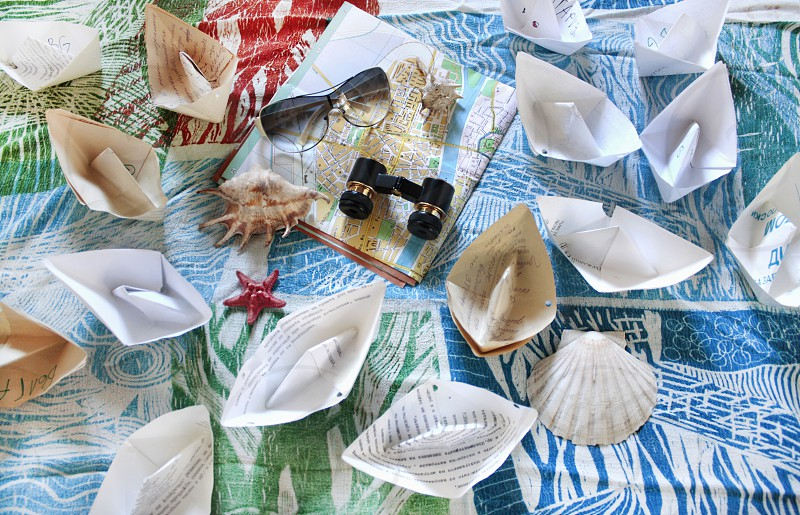 Summertime paper boats vacation moments photo