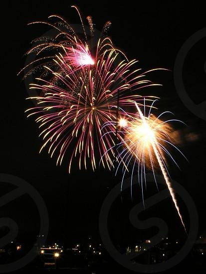 Fireworks near harbor waterfront photo