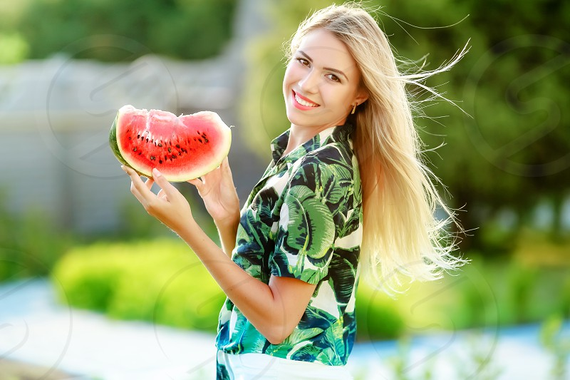 Sweet red watermelon and blonde girl photo