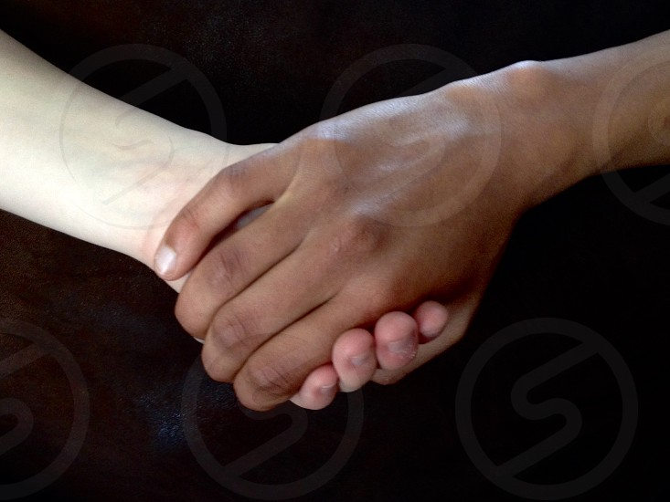 Hands relation love differents same strong together  photo