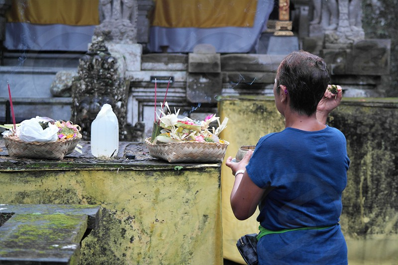 balinese praying in the temple photo
