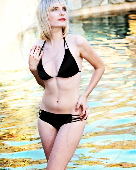 swimsuit model in pool  photo