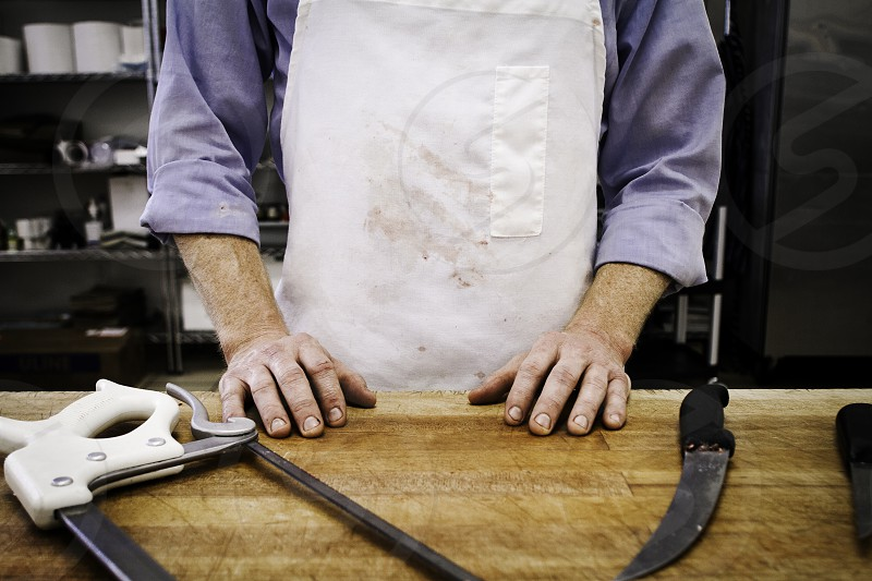 The hands of a a hard working butcher. butcher hands working work rough  photo