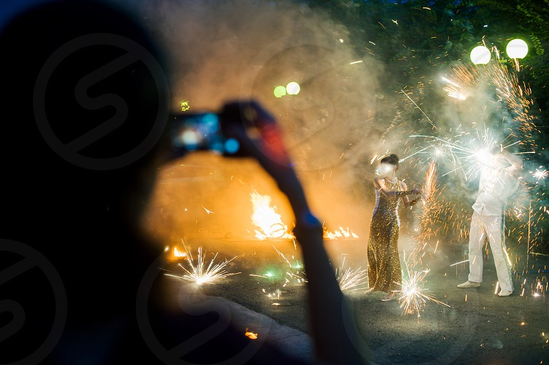 fire show in the open air in the dark. man and woman show tricks with fire photo