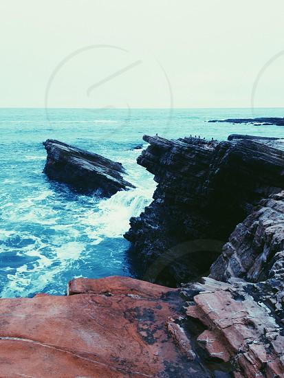 waves against rock shore photo