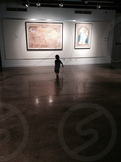 Little boy with his Louisville slugger in a museum. photo