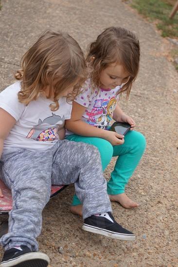 Outside • skateboard• cell phone• no play photo