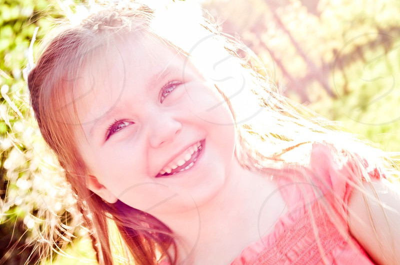 girl smiling in the sunshine photo