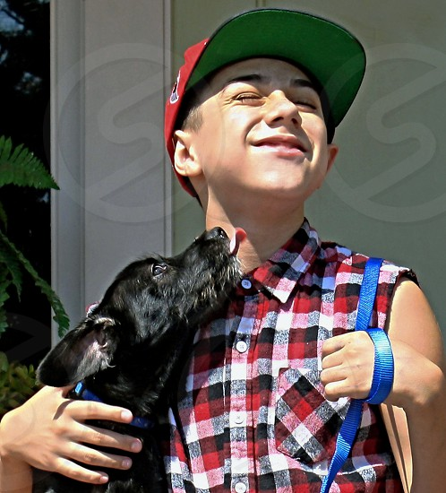 Dog licks the face of 'a boy photo