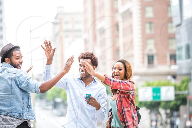 Millennials in the park celebrating spring break  African American friends photo