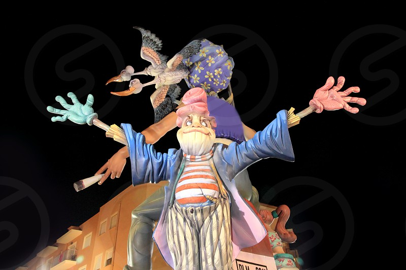 fallas from Valencia popular fest figures sculpture over black night sky in Spain photo