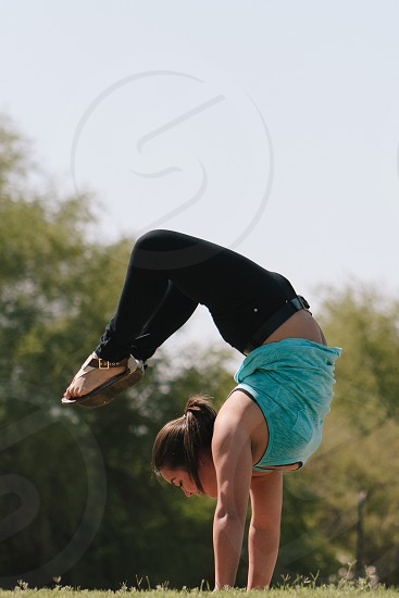 woman doing an upside down photo