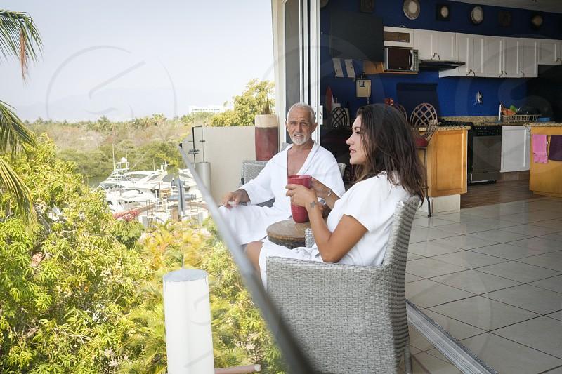 Couple sitting on balcony overlooking the marina of Nuevo Vallarta Nayarit Mexico photo
