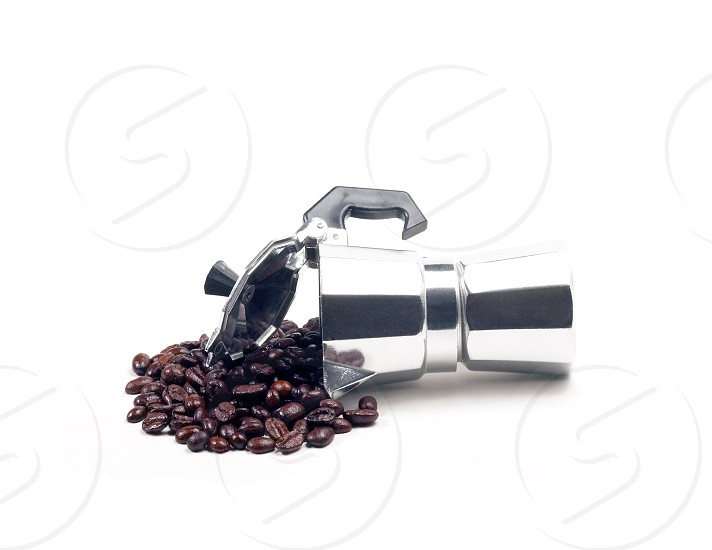coffee beans and mocha coffee machine on white background photo