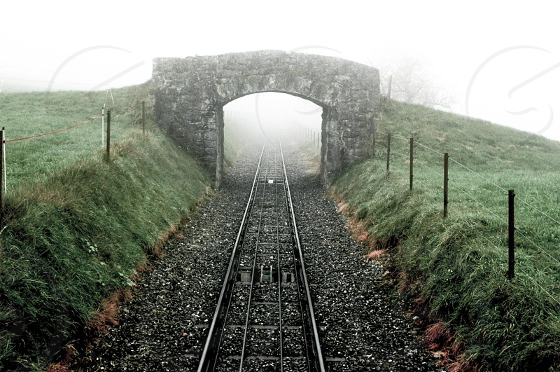 rail road track covered with fog photo