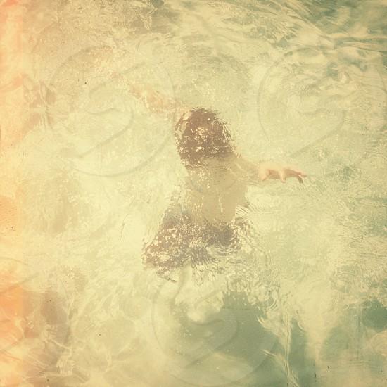 Childhood boy water swimming underwater photo