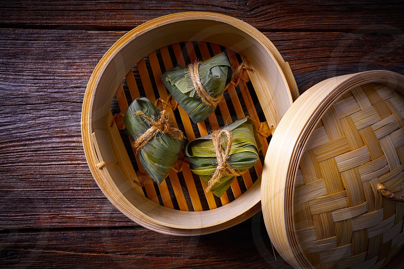 Zongzi Glutinous sticky Rice Dumplings recipe wrap with bamboo leaves asian food photo