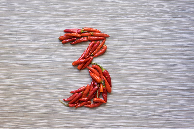 red peppers in shape of number 3 photo