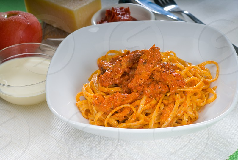 italian spaghetti pasta with fresh homemade tomato and chicken sauce photo